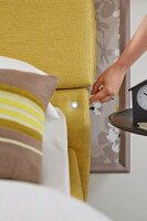 A headboard that can be adjusted at the touch of a button