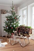 Decorated Christmas tree and traditional nativity set on vintage wooden sledge in front of lattice windows