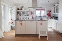 Festively decorated white country-house kitchen