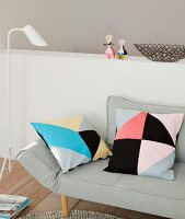 Cushions with homemade tangram-style covers