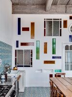 Stained glass elements in wall of loft-apartment kitchen