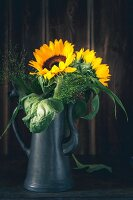 Sunflowers in metal coffee pot