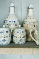 Vintage crockery on wooden shelf