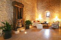 Ancient wooden press against stone wall in Mediterranean living room
