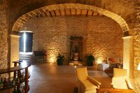 Stone walls and arched doorway in Mediterranean living room