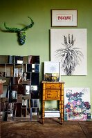 Collection of artworks on light green wall