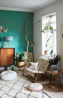 Arrangement of plants and green wall in retro living area of period apartment