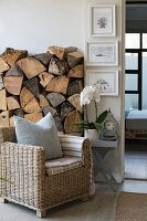 Wicker armchair in front of rustic stack of firewood in living area