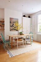 Vase of forsythia in retro dining area