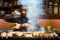 Grilled chicken skewers at the 'Tori Komachi' sake bar in Japan