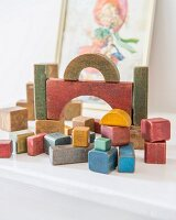 Vintage wooden building blocks in child's bedroom