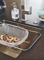 A sink with a stainless steel sink sieve