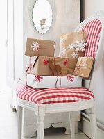 Wrapped Christmas presents on an upholstered chair with a red and white checked cover