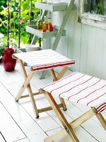 Folding stools covered with tea towels