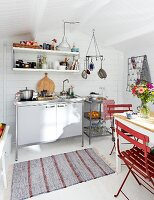 White, wooden, Scandinavian-style summer house with kitchenette