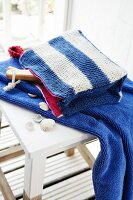 A knitted, blue and white striped make-up bag