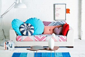 Sofa with colourful upholstery and scatter cushions