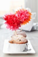 Muffins decorated with tissue paper pompoms