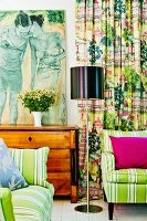 Contemporary painting on Biedermeier chest of drawers, striped sofas and curtain in bright shades of red and green