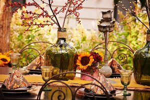 Outside dining table setting in autumnal color scheme.