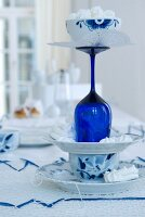 Blue and white bonbon stand made from plates, cup and blue wine glass