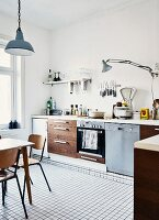 Large, bright kitchen in period apartment with mixture of DIY elements and vintage, flea market finds