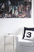 Number printed on scatter cushions on armchair and tray table below photo collage on wall
