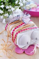 Egg carton used as Easter gift box decorated with ribbons & paper butterfly