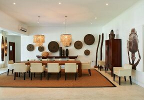 Dining room furnished in contemporary African style in Tanzanian hotel