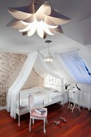 Romantic, elegant attic bedroom with white canopied bed, shiny patterned wallpaper and vintage ambiance