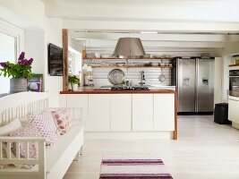 Modern, fitted kitchen in renovated country house with vintage ambiance