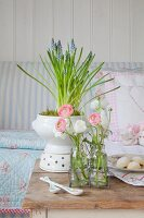 Spring arrangement of grape hyacinths and ranunculus on old table