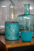 Turquoise containers and glass bottles