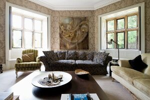 Patterned sofa, coffee table and Rococo armchair in polygonal living room