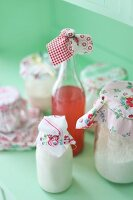 Jars and bottles decorated with scraps of romantic fabrics