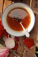 Ingredients for natural beauty treatments: honey, rose petals and lavender flowers
