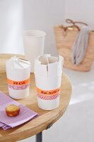 Closable metal containers for small cakes made from paper cups and masking tape