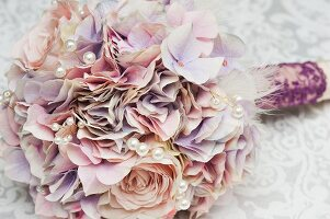 Bridal bouquet of pastel silk flowers with artificial pearls
