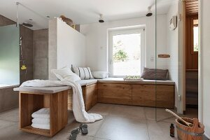A designer, spa bathroom with a comfortable chill-out bench and a sauna