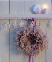 Wreath of feathers & satin ribbon as Christmas decoration