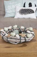 Hand-tied Easter wreath of rustic branches decorated with blown eggs
