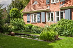 Brick house and rectangular garden pond