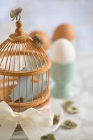 A bird cage as Easter decoration on a breakfast table