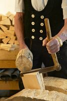 Joiner using a froe to make wooden shingles