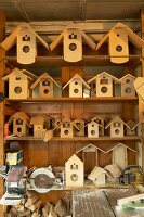 Bird nesting boxes and cases for cuckoo clocks in traditional workshop