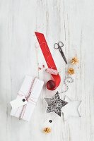 Gift wrapped in red and white and wrapping materials