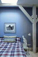 Blue wall and wooden beam structure in bedroom