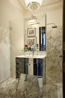 Shower area and vintage-style sink in elegant marble bathroom