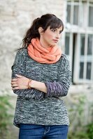 A hand-knitted plaited scarf made of a mixture of alpaca, silk and cashmere yarn