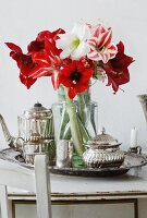 Bouquet of amaryllis of various colours on silver tray